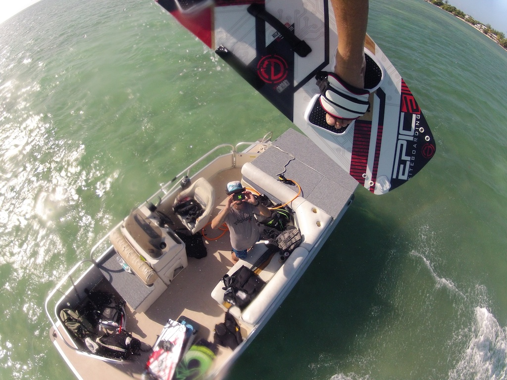 Jumping over OTHERSIDE BOARDSPORTS school boat.jpg