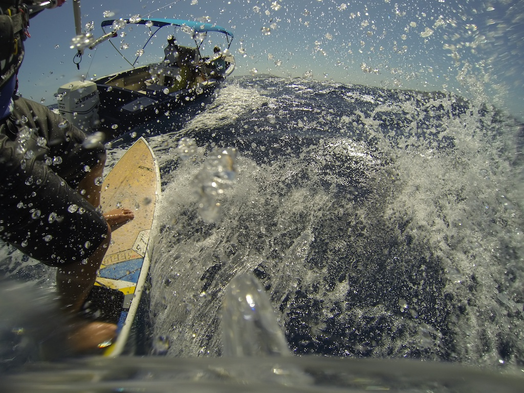 Surfing behind the boat on our way to the wave spot.jpg