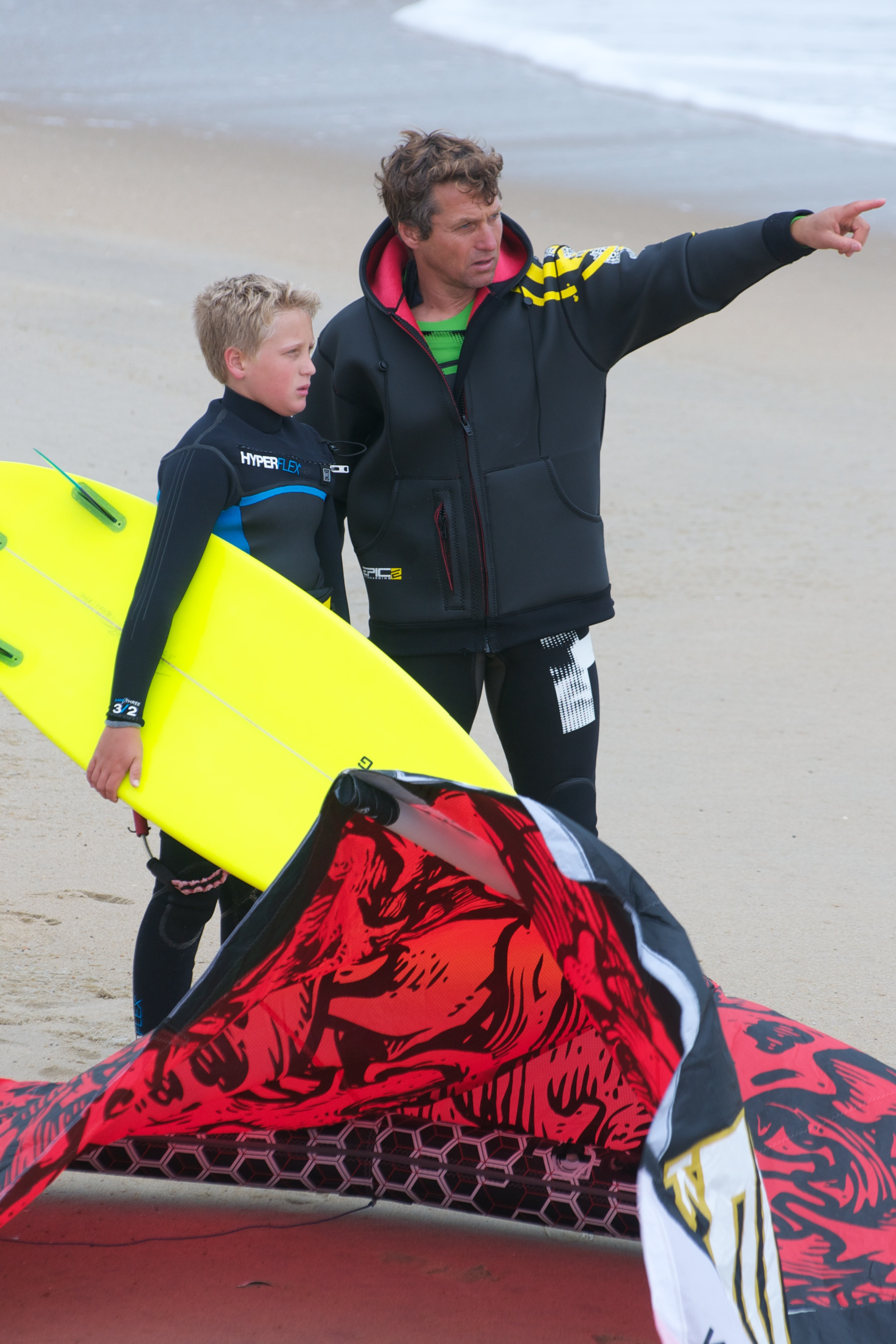 Dad showing how to venture in the waves.jpg