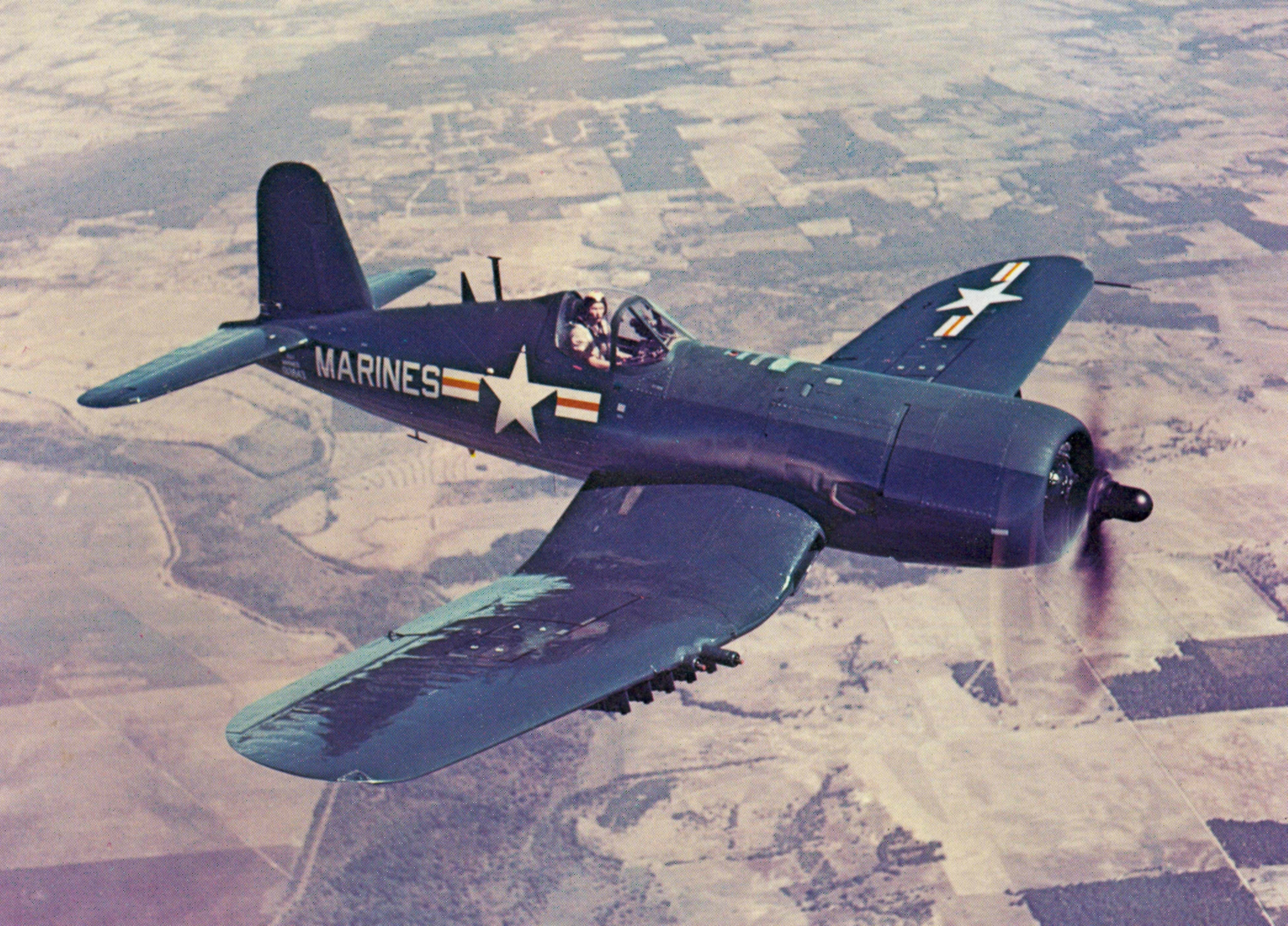 AU-1_Corsair_in_flight_1952.jpg