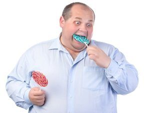fat-man-eating-candy-at-work.jpg